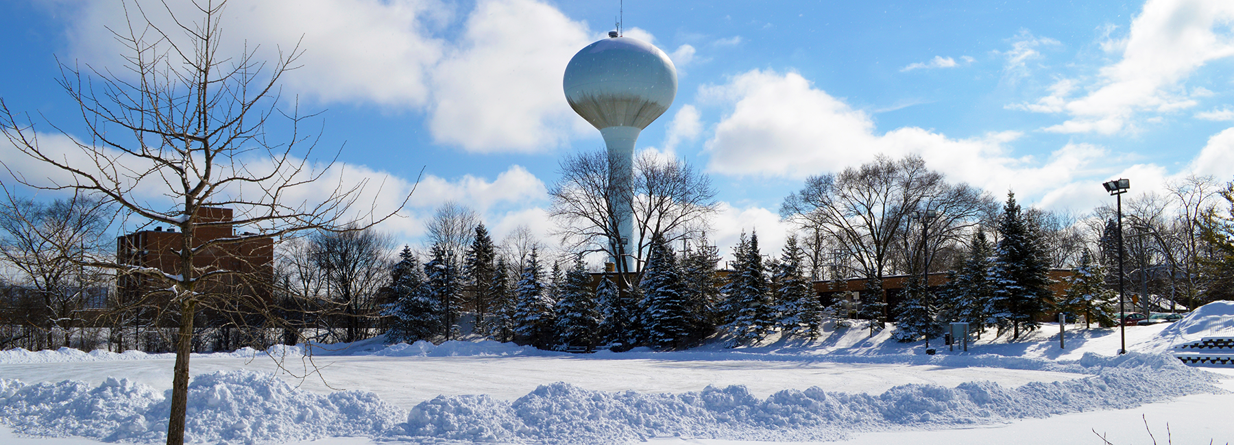 Water tower and snow on the ground