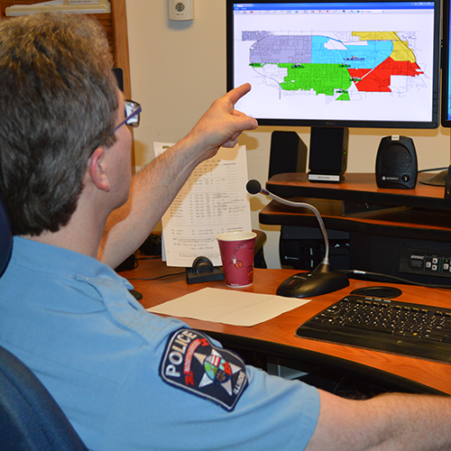 Police Dispatcher Pointing at Screen
